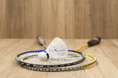 Shuttlecock and two racquets Royalty Free Stock Image