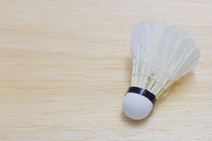 Shuttlecock on wood background Stock Photos