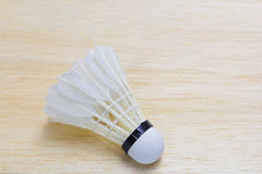 Shuttlecock on wood background Stock Photo