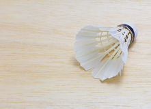 Shuttlecock on wood background Royalty Free Stock Photos