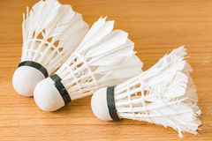 Shuttlecock on wooden background Stock Photos