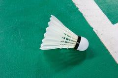 Shuttlecocks on badminton court Stock Photo