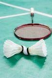 Shuttlecocks on badminton court Stock Photos