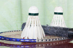 Shuttlecocks and badminton racket. Two shuttlecocks and badminton racket Royalty Free Stock Images