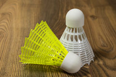 Shuttlecocks for badminton on a wooden floor Royalty Free Stock Photography