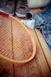 Shuttlecocks on a racket Stock Images