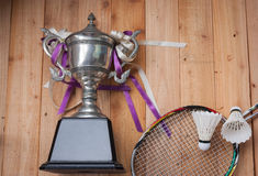 Shuttlecocks, rackets and badminton trophy Stock Photos