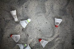 Shuttlecocks in sand. Color image of some shuttlecocks in the sand Stock Photo