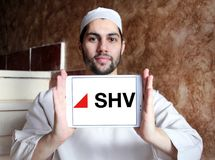 SHV Holdings logo. Logo of SHV Holdings on samsung tablet holded by arab muslim man. SHV Holdings is a privately owned Dutch trading company, regarded as one of Royalty Free Stock Photo