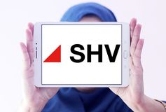 SHV Holdings logo. Logo of SHV Holdings on samsung tablet holded by arab muslim woman. SHV Holdings is a privately owned Dutch trading company, regarded as one Royalty Free Stock Photo