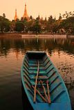 Shwe Dagon Pagoda at sunset, blue boat Royalty Free Stock Photo