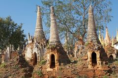 Shwe Inn Dain Pagoda complex. The ruined pagodas at the Shwe Inn Dain Pagoda complex, Indein village, Inle Lake, Myanmar. Shwe Inn Dain and its 1054 pagodas royalty free stock photos