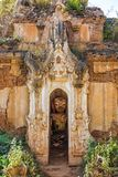 Shwe Inn Dein Pagoda Inle Lake Shan state Myanmar. Buddha statue hiding in the ruins of the Shwe Inn Dein Pagoda at Inle Lake Shan state in Myanmar Burma royalty free stock photos