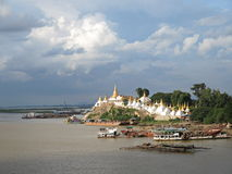 Shwe Kyat Yat Pagoda / Sagaing. Pagoda opposite Sagaing, near Mandalay, small harbour in the foreground Stock Photo