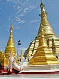 Shwe Muay Wan Temple. Shwe Muay Wan Paya is a Myawaddy's most important temple,a traditional bell-shaped stupa gilded with many kilos of gold and topped by more royalty free stock photography