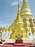 Shwe Muay Wan Temple. Shwe Muay Wan Paya is a Myawaddy's most important temple,a traditional bell-shaped stupa gilded with many kilos of gold and topped by more stock photo