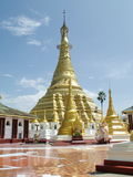 Shwe Muay Wan Temple. Shwe Muay Wan Paya is a Myawaddy's most important temple,a traditional bell-shaped stupa gilded with many kilos of gold and topped by more stock photography