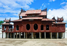 Shwe Yaunghwe Kyaung Monastery, Inle Lake, Myanmar. The Shwe Yaunghwe Kyaung Monastery is a beautiful monastery which built almost entirely of wood, and finely Stock Photo