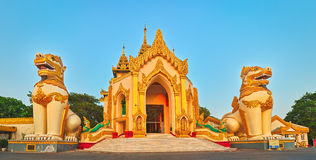 Shwedagon complex in Yangon. Myanmar. Western entrance of Shwedagon complex in Yangon. Myanmar. Panorama Royalty Free Stock Images