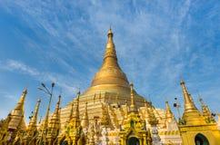 Shwedagon golden pagoda on blue sky background Stock Photos