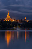 Shwedagon pagoda and Kandawgyi lake at night, Yangon, Myanmar Stock Photo