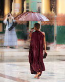 Shwedagon Pagoda, monks pray Stock Image