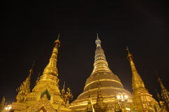 Shwedagon Pagoda. The Shwedagon Pagoda Shwedagon Pagoda is the most sacred Buddhist pagoda in Myanmar, as it is believed to contain relics of the four previous Stock Photos