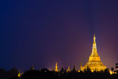 Shwedagon Pagoda, Myanmar (Burma). Night scene of Shwedagon Pagoda in Yangon (Rangoon), Myanmar (Burma). Sky lit by lightening. Copyspace. Ultra sharp high Royalty Free Stock Photography