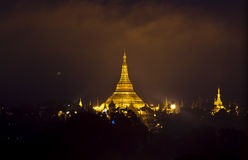 Shwedagon pagoda. In night sky with orange cloud, Yangon, Myanmar Stock Photo