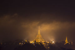 Shwedagon pagoda. In night sky with orange cloud, Yangon, Myanmar Stock Images