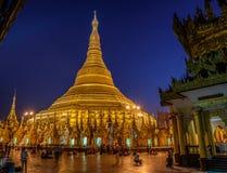 Shwedagon Pagoda Temple at night Stock Photos