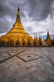 Shwedagon Pagoda Temple shining in the beautiful sunset in Yango Stock Photography