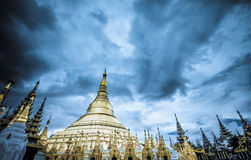 Shwedagon Pagoda Temple shining in the beautiful sunset in Yango Stock Image