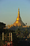 Shwedagon Pagoda Temple with village below in the morning light Royalty Free Stock Image