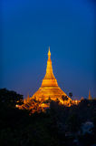 Shwedagon Pagoda Temple with village below in the twilight at Ya Stock Image