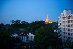 Shwedagon Pagoda Temple with village below in the twilight at Ya Royalty Free Stock Photo