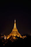 Shwedagon Pagoda_yangon. The magnificent and famous Shwedagon pagoda, Yangon (Rangoon) at night. This pagoda is one of the most holy places in Myanmar and is Stock Photography