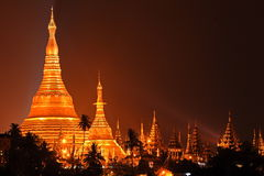 Shwedagon pagoda, Yangon, Myanmar. Night shot Shwedagon pagoda over the roof top of some hotel, Yangon, Myanmar Royalty Free Stock Image