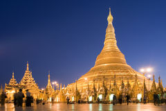 Shwedagon pagoda in Yangon, Myanmar (Burma). Shwedagon pagoda in Yangon (Rangoon) in Myanmar (Burma) in the evening. This is the most sacred place for the Royalty Free Stock Photos