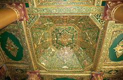 Shwedagon Pagoda, Yangon, Myanmar. Details of the ceiling in a temple in the courtyard of the Shwedagon Pagoda, a gilded stupa located in Yangon, Myanmar. The 99 Stock Photography