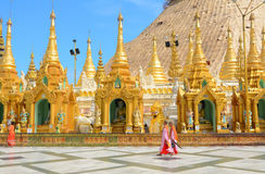 Shwedagon Pagoda in Yangon, Myanmar. YANGON, MYANMAR - JAN 14, 2015. Burmese people visit at Shwedagon Pagoda in Yangon, Myanmar. Shwedagon Pagoda is the most Stock Images