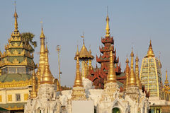 Shwedagon Pagoda, Yangon, Myanmar. Pagodas in the courtyard of the Shwedagon Pagoda is a gilded stupa located in Yangon, Myanmar. The 99 metres tall pagoda is Stock Images