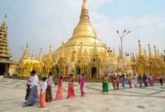 Shwedagon Pagoda in Yangon, Myanmar. Prayers walking at Shwedagon Pagoda in Yangon, Myanmar. Shwedagon Pagoda is the most sacred Buddhist pagoda for the Burmese Royalty Free Stock Photos