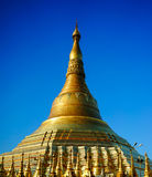 Shwedagon Pagoda in Yangon, Myanmar. Top of Golden Stupa of Shwedagon Pagoda in Yangon, Myanmar. Shwedagon Pagoda is the most popular and well-known pagoda in Royalty Free Stock Photography