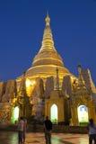 Shwedagon Paya by Night. With visitors admiring the scene Royalty Free Stock Photos