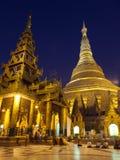 Shwedagon Paya by Night. With people praying at its base Royalty Free Stock Photos