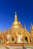 Shwedagon Paya Myanmar. Famous Shwedagon Pagoda under bright blue sky Royalty Free Stock Photo