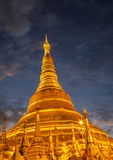 Shwedagon. The shiny golden Shwedagon Pagoda at dusk, 6s long exposure with blurred clouds in the night sky, Yangon, Myanmar, Southeast Asia stock photo