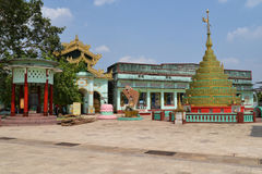 Shwemawdaw Pagoda at Bago, Myanmar. Bago, Myanmar - May 3, 2014: The Shwemawdaw Pagoda with prayers and tourists sightseeing on May 3, 2014 in Bago, Myanmar royalty free stock image