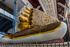 The feet of the colossal statue of reclining Buddha in Bago, Myanmar stock photography